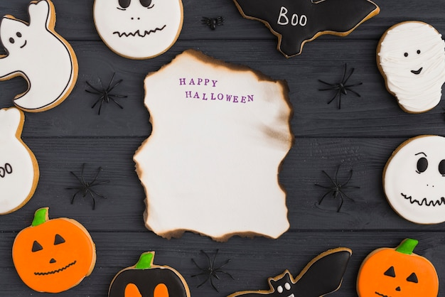 Burning paper between halloween gingerbread and decorating spiders