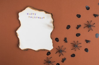 Burning paper near decorating spiders and skulls