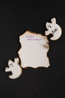 Burning paper near ghost gingerbread