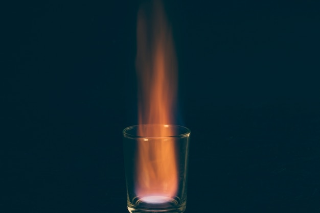 Burning shot of alcohol on dark background