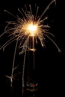 Burning sparkler in bottle