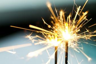 Burning sparklers in night