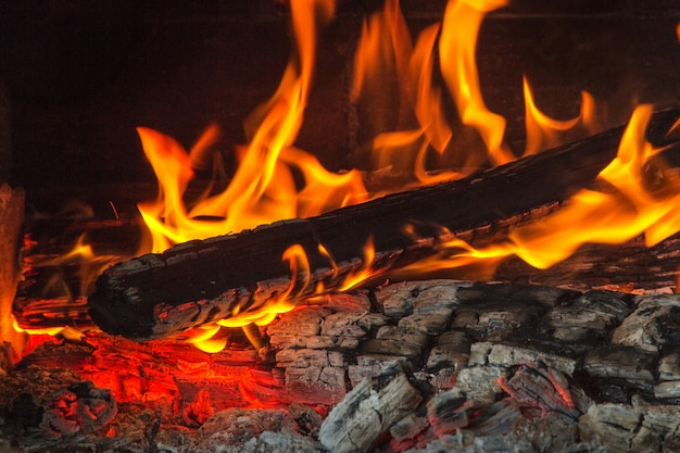 Burning wood at night. flame and fire sparks