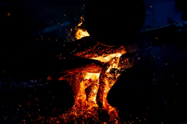 Burning wood at night.
