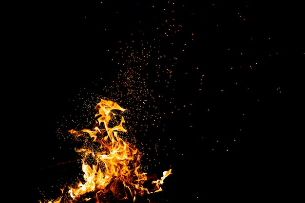 Burning woods with firesparks, flame and smoke