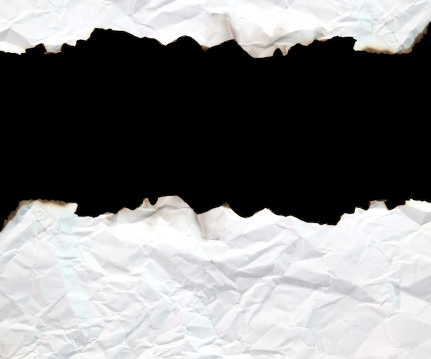 Burnt edge paper with space for text on black background.