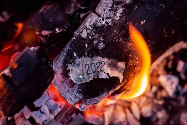 Burnt paper with inscription in campfire