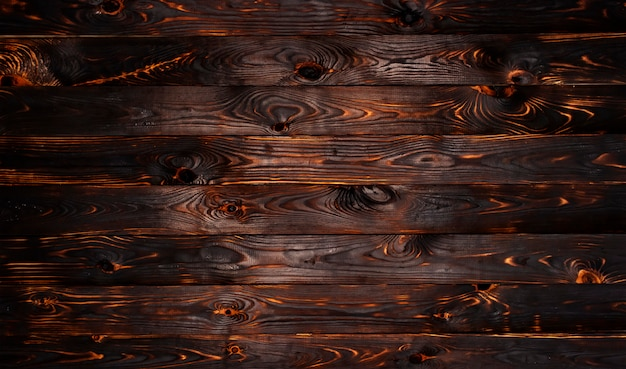 Burnt wooden board texture background