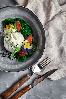 Burrata salad with strawberries and seaweed