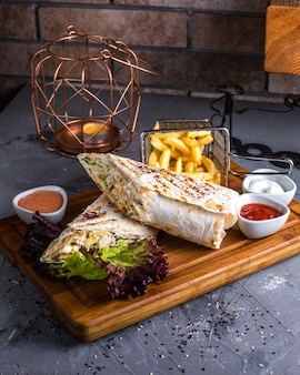 Burrito with french fries and vegetables