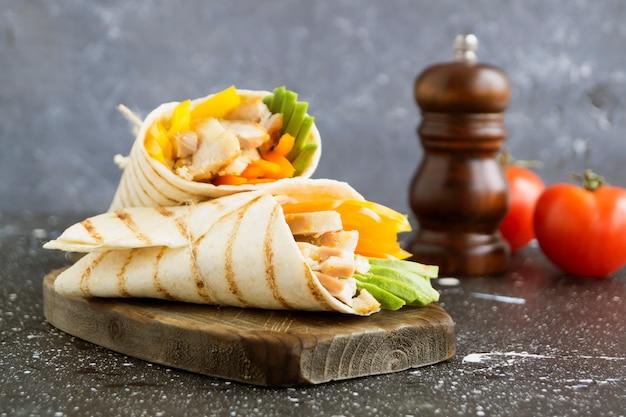 Burrito with grilled chicken and vegetables (fajitas, pita bread, shawarma)