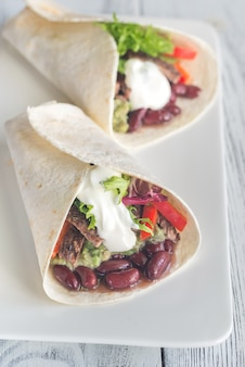 Burritos with meat and guacamole