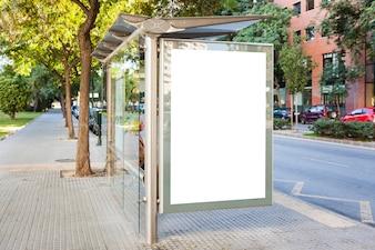 Bus stop billboard in green city