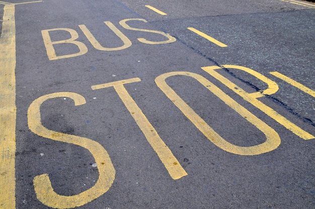 Bus stop sign on the road in united kingdom london