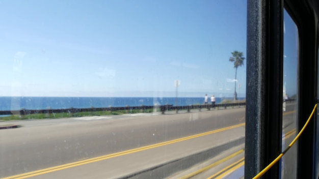 Bus window, pacific coast highway, freeway 101, california usa. road trip along summer ocean or sea.