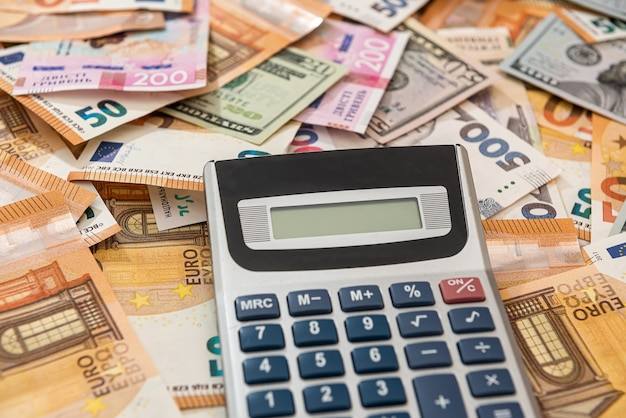 Business accounting financial background euro hrivna dollar and calculator