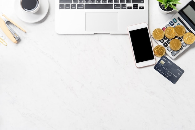 Business, accounting and payment concept financial information isolated on a modern marble office table, mock up, top view, copy space, flat lay, close up