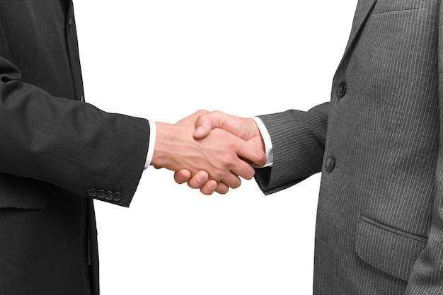 背景のビジネス契約ハンドシェイク