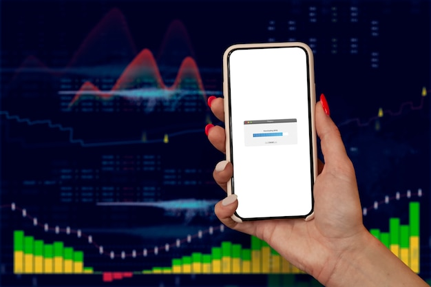 핵심 성과 지표 대시보드 개념을 사용한 비즈니스 분석. 한 여성의 손에 있는 스마트폰에 데이터를 로드하고 있습니다.