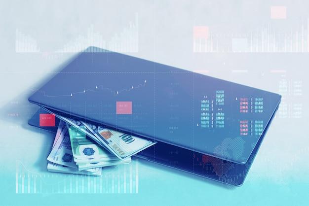 핵심 성과 지표 대시보드 개념을 사용한 비즈니스 분석. 온라인 작업 및 투자 개념입니다. 흰색 바탕에 달러와 유로 지폐 뭉치가 있는 노트북.