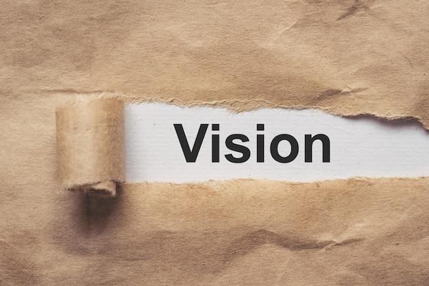 Бизнес и финансы. оборванная оберточная бумага, текст - видение.
