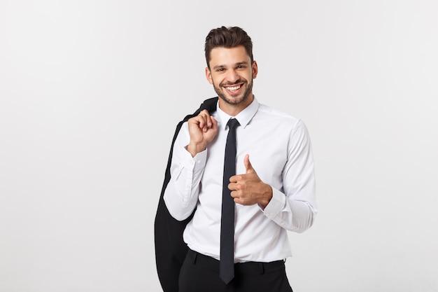 Бизнес и концепция офиса - красивый умный бизнесмен