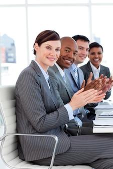 Business applauding a good presentation