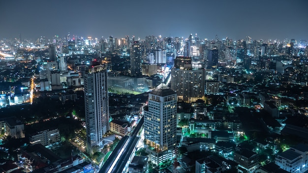 Business area in bangkok, thailand, showing buildings and traffic at night
