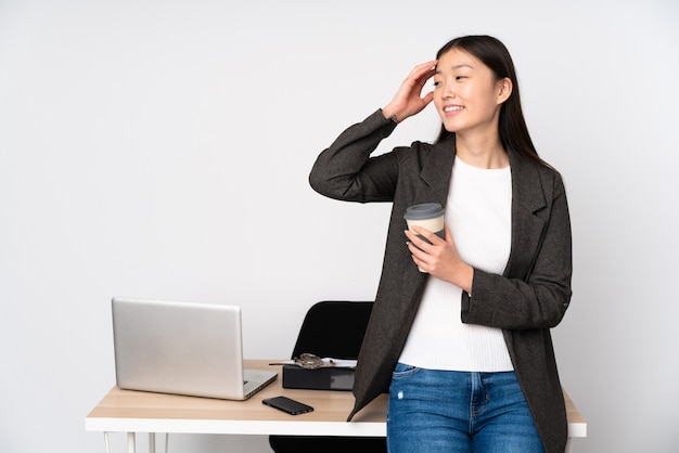 Business asian woman in her workplace on white wall has realized something and intending the solution