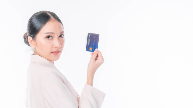 Business asian woman showing credit card for payment shopping online , paying by credit card online shopping  e-commerce telemarketing concept , isolate on white background with copy space