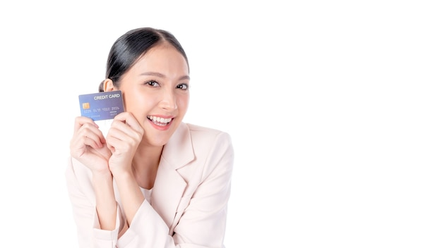 Business asian woman showing credit card for payment shopping online , paying by credit card online shopping  e-commerce telemarketing concept