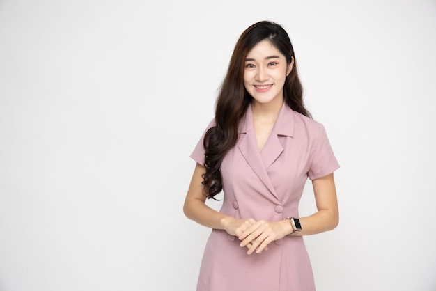 핑크 드레스 미소에 비즈니스 아시아 여성