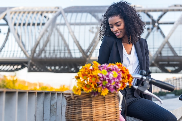 Business black woman with vintage bicycle