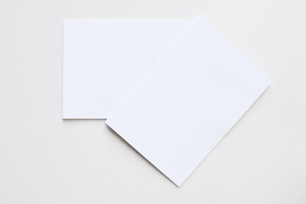 Business blank white card placed on the desk top view.