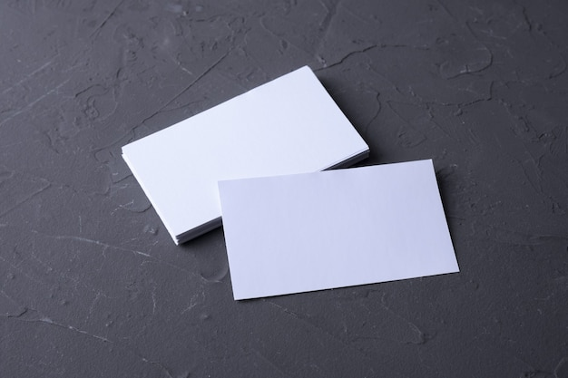Business card blank on beton rock background. corporate stationery, branding mock-up. creative designer desk. flat lay. copy space for text. template for id.