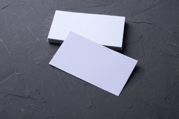 Business card blank on beton rock wall. corporate stationery. creative designer desk. flat lay. copy space for text.