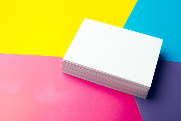 Business card blank over colorful abstract background.