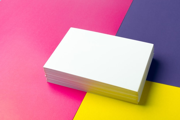 Business card blank over colorful papers