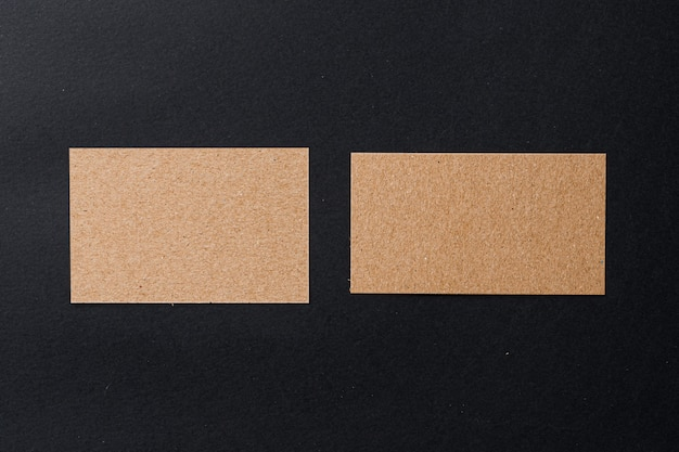 Business card of a craft paper on black wall