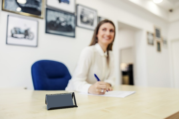 Business card holder in focus and businesswomen in the technical inspection office