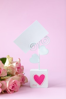 Business card, holiday card on a pink. postcard february 14, valentine's day.