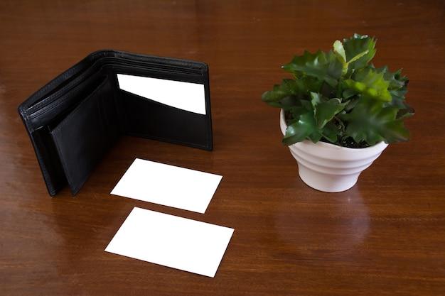 Business card mockup wallet wood plant