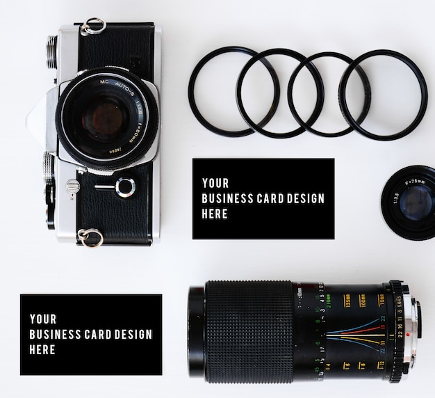 Business card mockup with old film camera and lenses with filters and glasses
