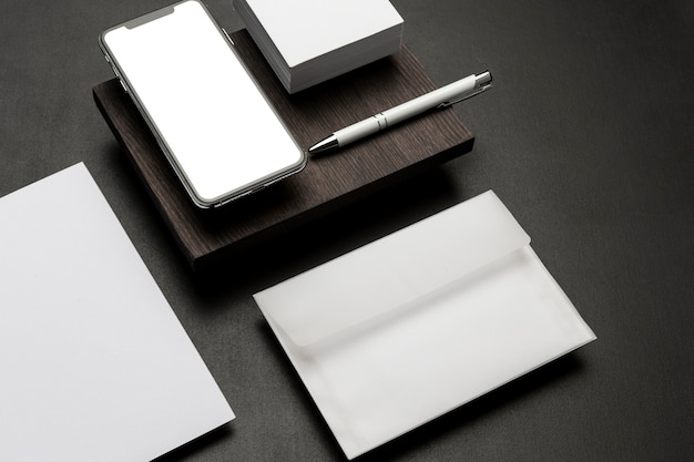 Business card papers and smartphone copy space