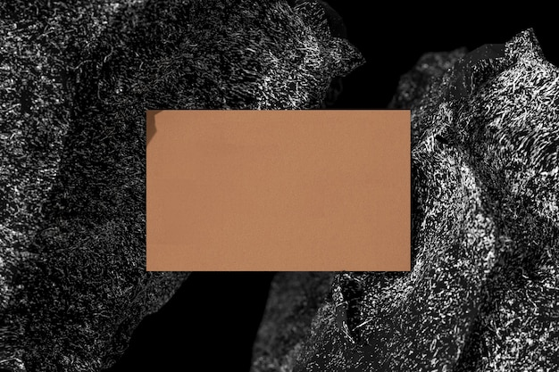 Business card placed between two stones. 3d render.