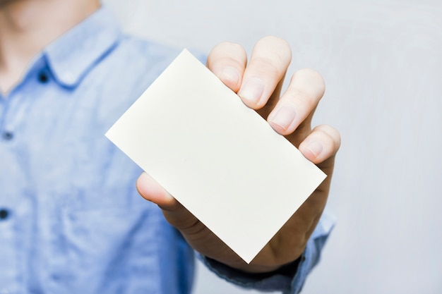 Business card prototype held by hand of businessman casual style