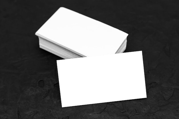 Business card template or mockup, white paper on a black background.