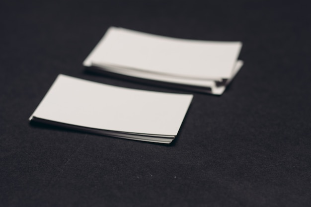 Business cards on a dark table mockup copy space