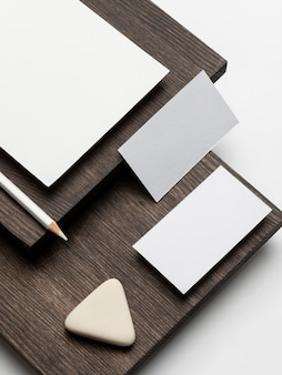 Business cards and eraser on wooden modern stand high view