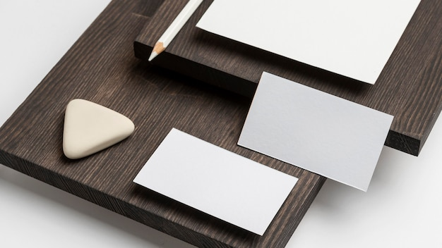 Business cards and eraser on wooden modern stand